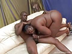 Big black cutie readily wraps her lips around friend`s thick dong.